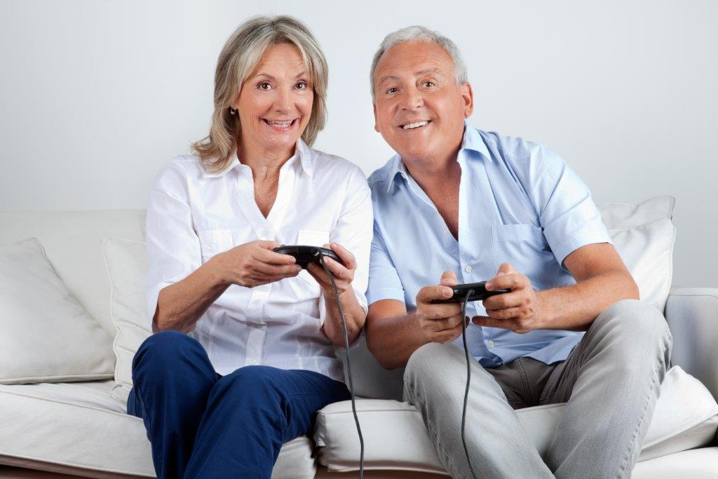 Older Couple Playing Video Games